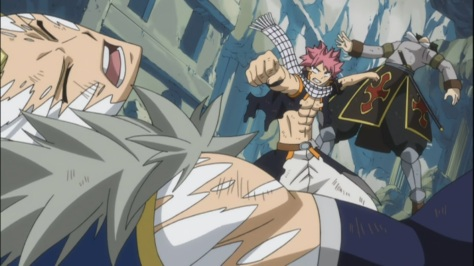 Natsu smashes both Rogue and Sting