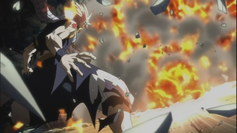 Rogue overwhelmed by Natsu's fire