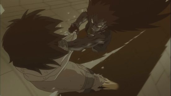 Gajeel punches Rogue