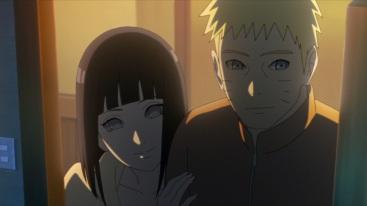 Hinata and Naruto look at sleeping Boruto